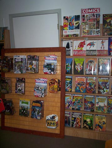 Action figures and DC Comics collections.