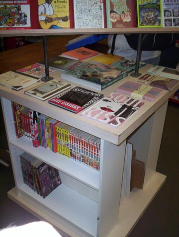 Featured manga volumes and art collections.